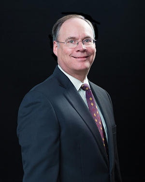 doug dickson, man with glasses and burgundy tie