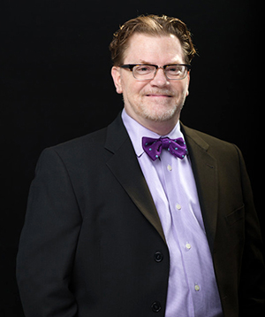 Jeff Covolo, man with purple bowtie and glasses